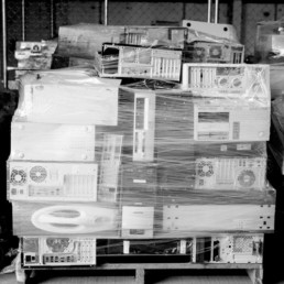 Computers wrapped on a pallet for recycling