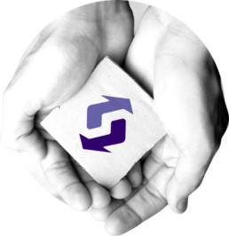 Black and white circle image with hands holding a piece of paper with the purple ANZRP logo